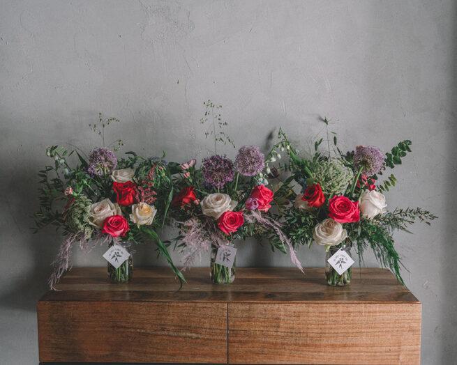 Triple pink and purple floral arrangement