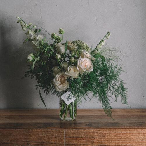 White roses floral arrangement in a jar
