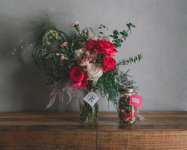 Large jar of flowers and candy