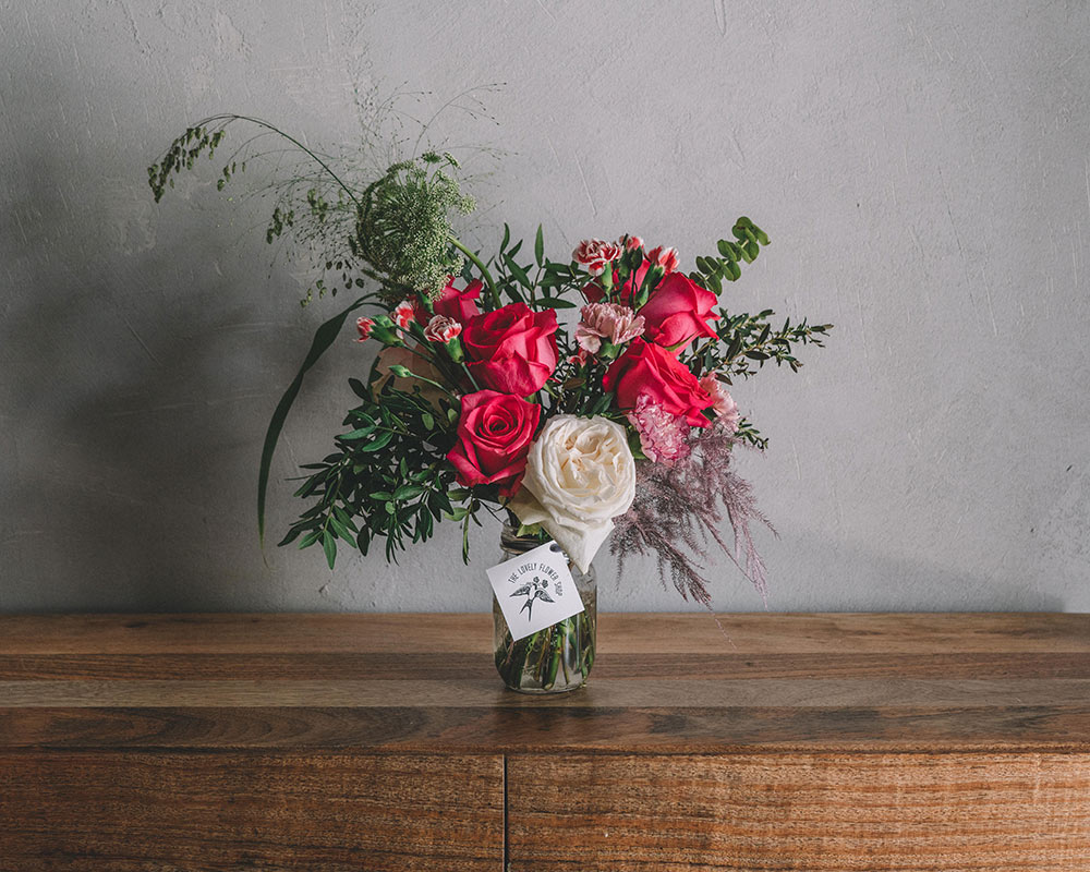 A lovely jar of pink and red roses