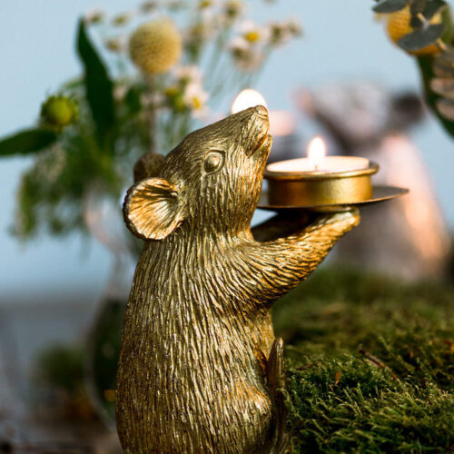 A pair of gold mice candle holders