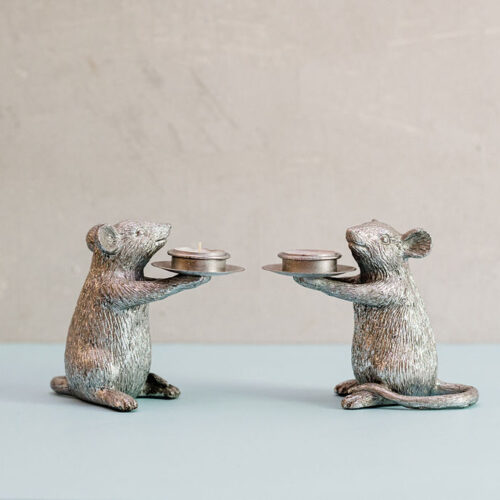 A pair of silver mice candle holders