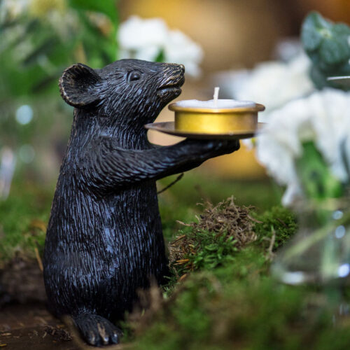 A pair of black mice candle holders