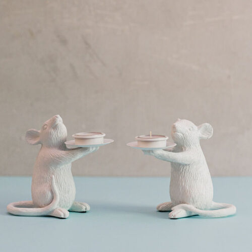 A pair of white mice candle holders